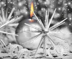 silver christmas silver background with candle and christmas tree ornament
