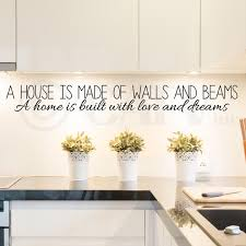 amazon com a house is made of walls and beams a home is built