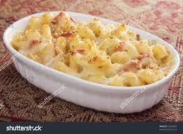 creamy baked macaroni cheese sundried tomatoes stock photo