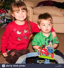 sister pulling a funny face with her brother 4 year old