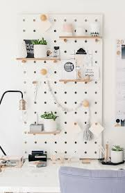 peg board pegboard with shelves and pegs white the modern nursery