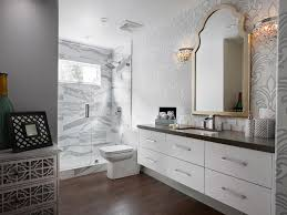 white floating vanity with gray quartz countertop under gold
