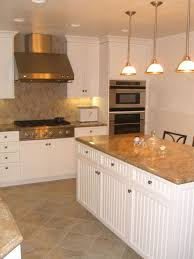 Unfinished Beadboard - white beadboard cabinets tan granite tops stainless appliances