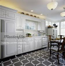 Pictures Of Country Kitchens With White Cabinets Eclectic Country Kitchen With White Cabinets Drawers Tiled Floor