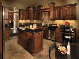 kitchens with dark cabinets and light countertops exposed beam