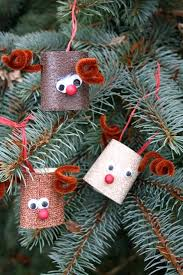 primitive handmade ornaments out of painted canning lids
