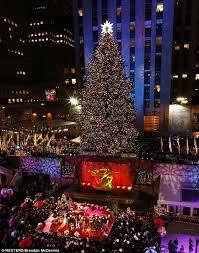 rockefeller center tree lights go on as shakira and