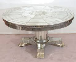 vintage circular pedestal base dining table with mirror surface at