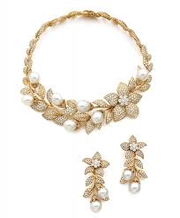 set of gold a set of diamond cultured pearl and 18k yellow gold jewellery by