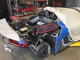 off road porsche 918 spyder porsche 918 spyder undergoing servicing looks like v8 open heart