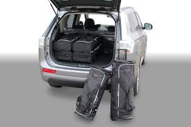 mitsubishi crossover white outlander mitsubishi outlander phev 2013 present car bags travel