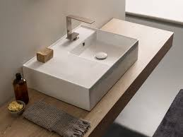 semplice washbasin with integrated countertop by nic design