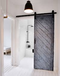 15 sliding barn doors that bring rustic to the bathroom