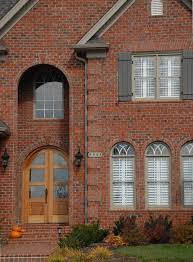 Corbelled Brick From Semicircular Arches And Keystones To Windows Framed By Stack