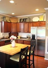 kitchen cabinets top decorating ideas ideas for decorating above kitchen cabinets elabrazo info