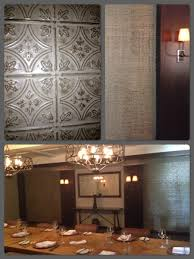 faux tin tile walls in restaurant private dining room decorative