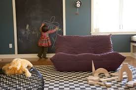 playroom interior design feature black and white checkered rug and