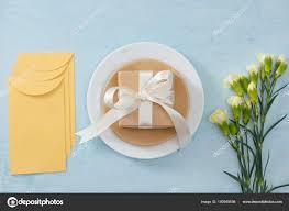 tet envelopes tet concept yellow envelopes table gift box plate flowers