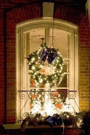 lighted christmas wreaths for windows christmas window decoration ideas lovetoknow