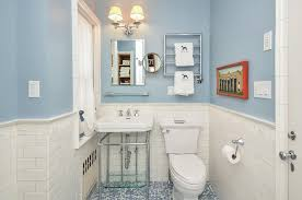 traditional powder room with penny tile floors by houlihan