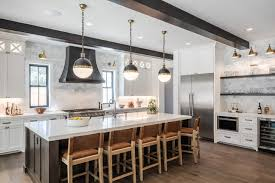 pictures of white kitchen cabinets with island 4 kitchens with white cabinets and a wood island