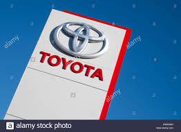 toyota dealer toyota dealership sign against blue sky stock photo royalty free