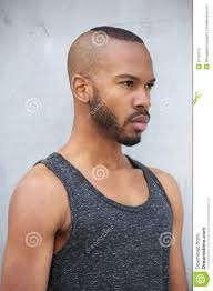 african american male fashion model with modern hairstyle stock