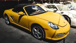 Porsche Boxster Yellow - here is how much it really costs to own a cheap porsche boxster