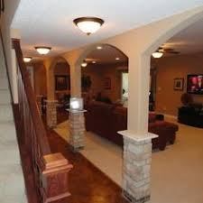 awkward pillars or support beams in your basement make them part