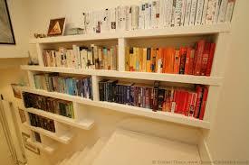 design smart floating bookcase doherty house build floating
