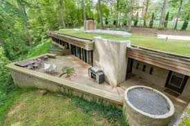 70s bunker like house is actually a dream curbed a berm house features soil that s been packed against the outer walls photos via zillow
