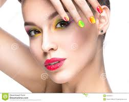 beautiful model with bright colored makeup and nail polish in