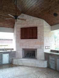 stylish outdoor storage cabinets with doors above nice fireplace