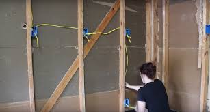 insulating a garage adding outlets and installing osb boards