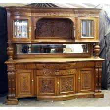 heavily carved antique oak sideboard with curio top for sale