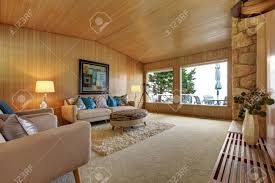 beautiful house interior with wooden plank trim and rock