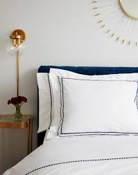 blue headboard with gold nightstand transitional bedroom