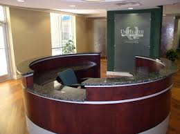Granite Reception Desk Delta Sky Lounge Features Tables In Cloud White Zodiaq Quartz