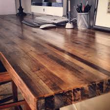 7ft x 2ft butcher block desktop 2 coats of minwax stain 1 coat