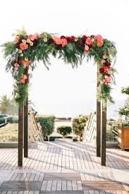 wedding arches tasmania burgundy and pink floral arch with garden roses oak and the owl