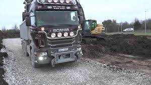 volvo site volvo ec380d loading earth on the volvo and scania trucks at a
