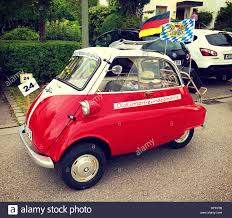 cars bmw red vintage car bmw isetta 300 shiny red and white stock photo