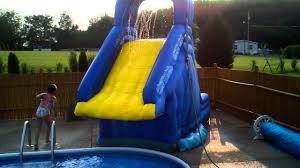 crazy fun on the inflatable banzai blaster pool slide in ground