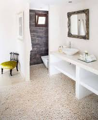 bathroom with white vanity with vessel sink and mirror and pebble