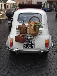 perfect sighting of an old fiat 500 including wine baskets for