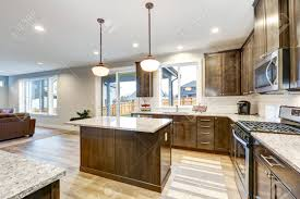 white kitchen countertops with brown cabinets light filled northwest kitchen design with kitchen island