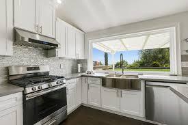 white shaker kitchen cabinets with gray quartz countertops open concept kitchen gray quartz countertops issaquah wa