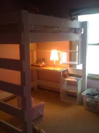 unique simple teenage loft bed with desk aside double hung window