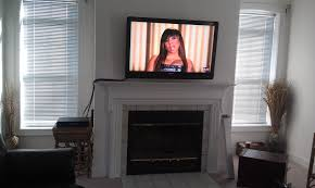 tv mounted above fireplace where to put components home design