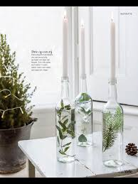glass bottles with greenery used as a candleholder for the home
